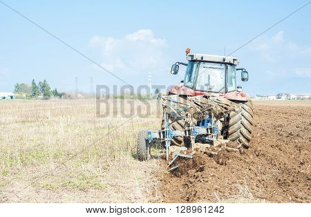 Tractor Plowing The Stubble Field