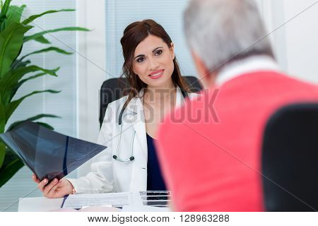Patient talking to his doctor during a visit