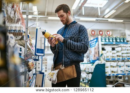 Handyman Selecting His Purchase In A Store