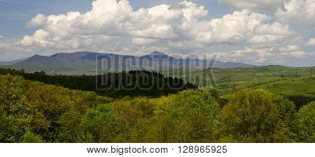 Mountain range panorama picturesque landscape with summer clouds and mountain forest
