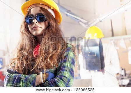 Portrait Of Pretty Female Worker In A Steel Mill