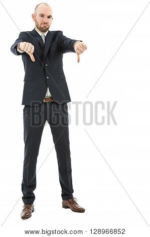 Business man shows his dislike by showing thumbs down. Isolated on white background.