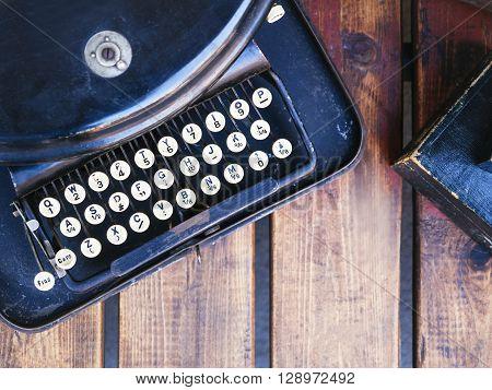 Vintage Typewrite on wooden desk Top view Journalist writer concept