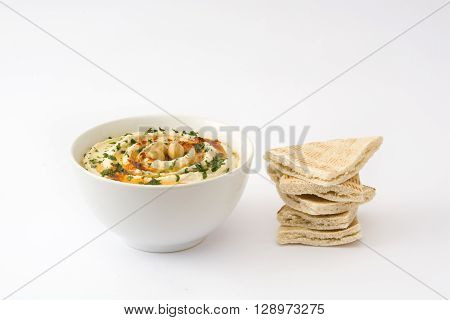 Hummus with pita bread isolated on white background