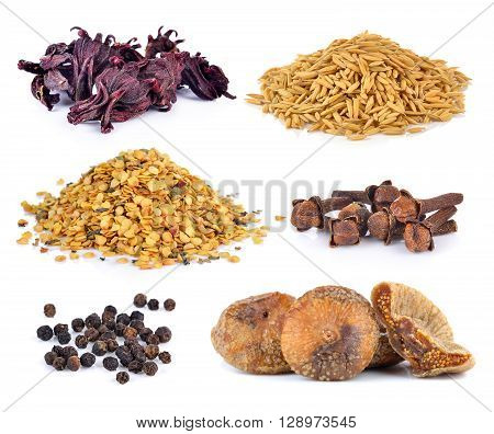 Dried figs pepper corn chili seeds Spice cloves rice grains Dried okra on white background