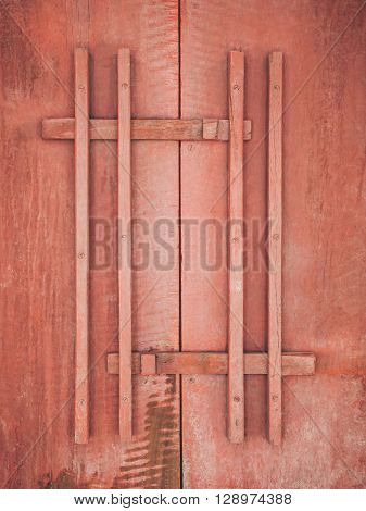 Red Wooden door with handle texture background
