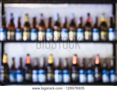 Blurred Wine Bottles on shelves Bar Background