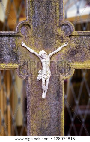 Close view of a metal crucifix on an old metal cross