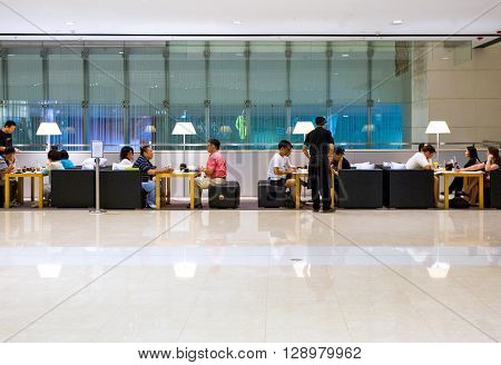 Hong Kong China - September 23 2007: People in a coffee bar of the IFC Mall.