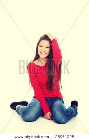 Relaxing woman sitting on the floor.