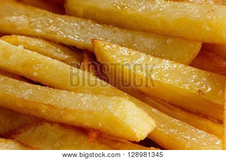 Golden delicious fries close up may be used as background