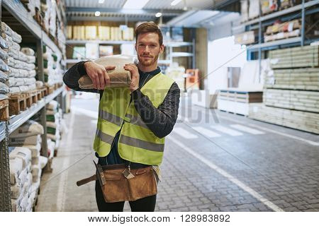 Young Handyman Selecting Supplies In A Warehouse