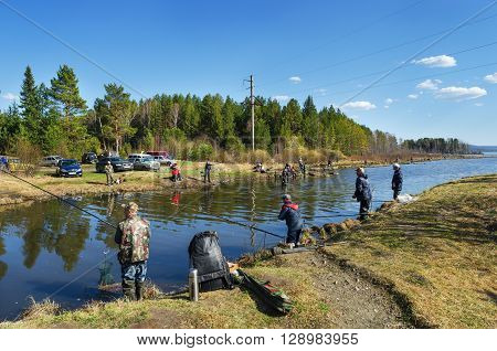 MIDDLE URALS RUSSIA - MAY 5 2016: Many fishermen catch fish in the mouth of the river Kanava during the spring fishing activity. Middle Ural. Russia
