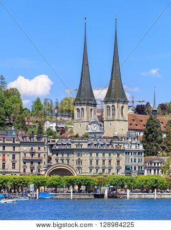 Lucerne, Switzerland - 8 May, 2016: view on Kurplatz square with the towers of the Church of St. Leodegar in the background. The Church of St. Leodegar is the most important church and a landmark of the city.