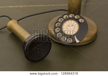 Antique phone with control dial old rotary telephone