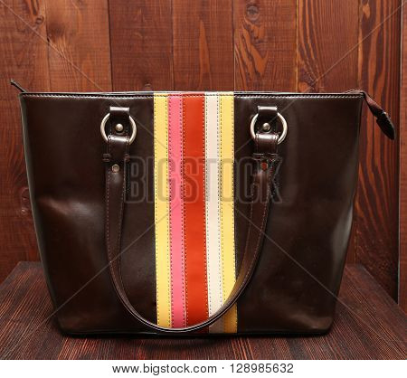 Woman's Leathure Brown Handbag On Wooden Background