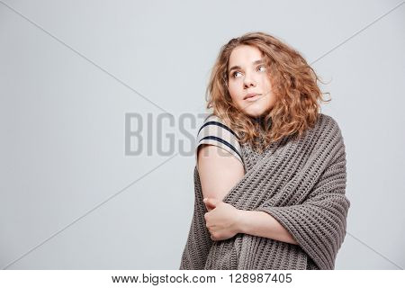 Pensive woman looking away at copyspace isolated on a white background
