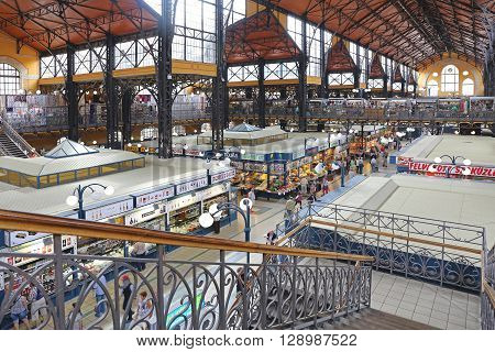 BUDAPEST HUNGARY - JULY 13: Shoppers in Central Market Hall in Budapest on JULY 13 2015. People Shopping in Great Market Hall in Budapest Hungary.