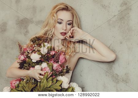 Gorgeous woman with beautiful bouquet