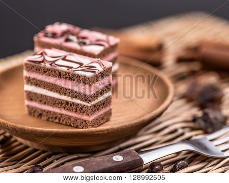 Layered mini cakes served on plate, studio shot