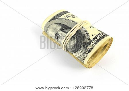 roll of banknotes nominal value of one hundred US dollars on a white background with shadow