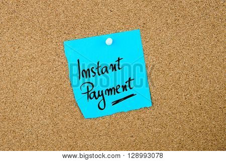 Instant Payment Written On Blue Paper Note