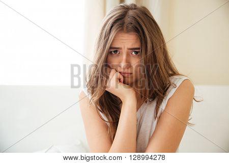 Sad woman looking at camera