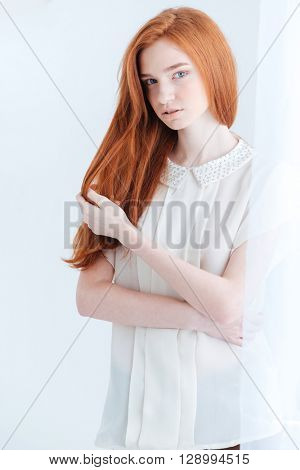 Potrait of a pretty redhead woman looking at camera