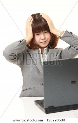 portrait of young Japanese businesswoman shocked on white background