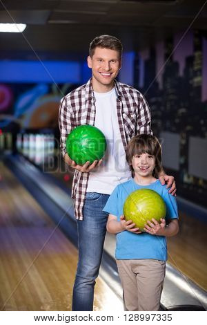 Dad and son in bowling