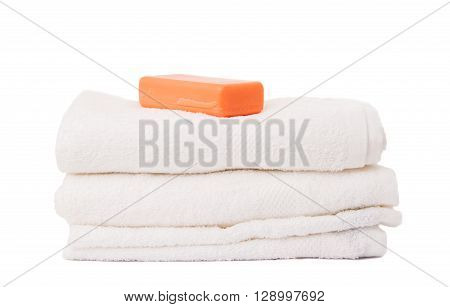 soap and towels on white background, fluffy, dry, fabric