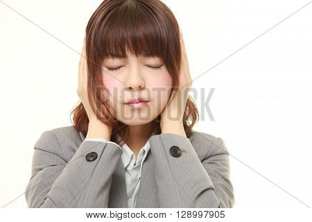 portrait of Young Japanese businesswoman suffers from noise on white background