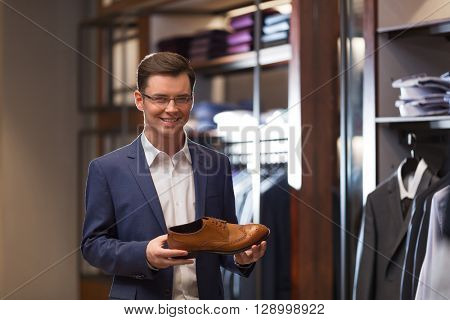 Smiling man in a suit indoors