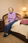 Elderly woman in her bedroom at retirement community center.