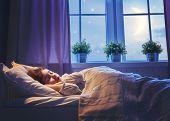 Постер, плакат: Adorable little child girl sleeping in the bed Quiet sleep quiet starry night