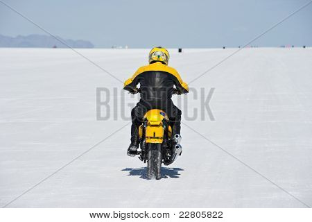 WENDOVER, UT - AUGUST 13: A motorcycle races on the Bonneville Salt Flats during Bonneville Speed Week on August 13, 2011 near Wendover, UT.