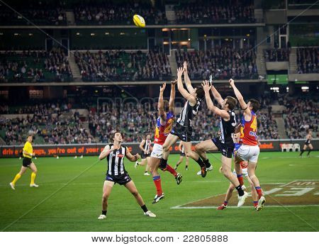 MELBOURNE - AUGUST 20 : Alex Fasolo (C) takes a strong mark during Collingwood's  win over Brisbane - August 20, 2011 in Melbourne, Australia.