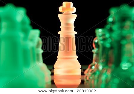 multicolored chess pieces in dark
