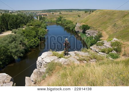 Tourist On A Cliff Above The River