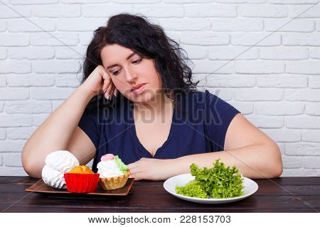 poster of Young Upset Overweight Woman Bored Of Diets Choosing Between Healthy And Junk Food. Dieting, Healthy