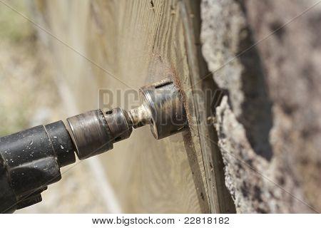 Carpenter Drilling Hole In Door