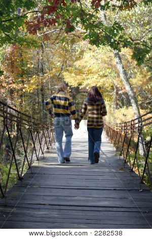 Couple On A Swinging Bridge