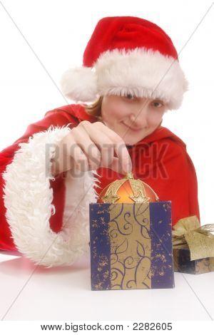 Santa Girl With Xmas Ball