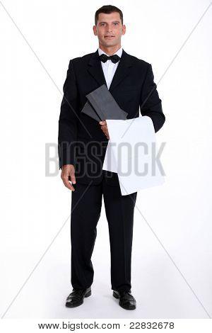 Male waiter stood holding menu