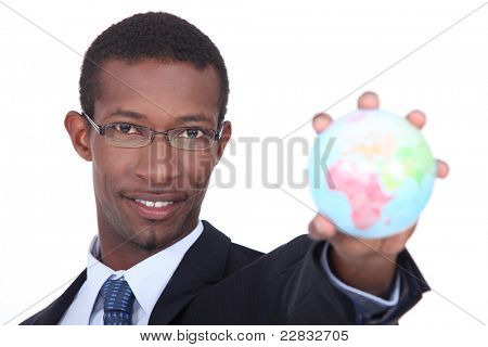 Businessman holding the world in the palm of his hand
