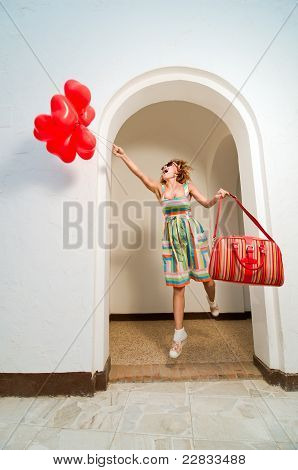 Beautiful woman with heart shaped baloons
