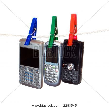 Three Mobile Phones On A Clothes Line 2