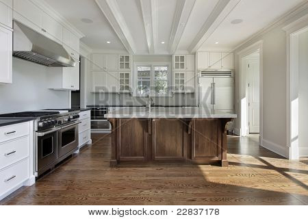 Kitchen in new construction home with white cabinetry