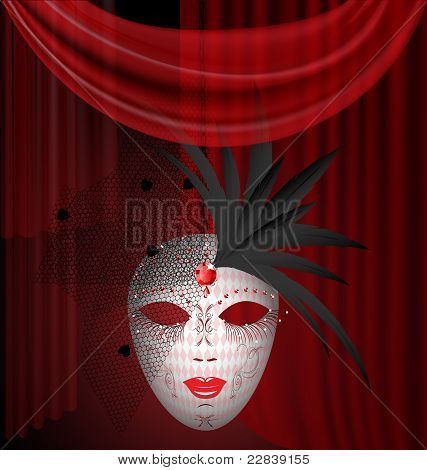 red drape and carnival mask