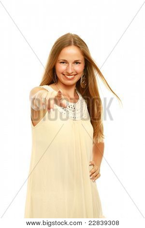 Young female pointing a finger at you isolated over white